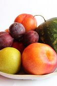 different fruits watermelon pears plum and nectarine