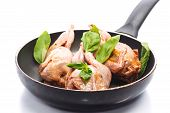 image of quail  - quail marinated in a frying pan before frying - JPG