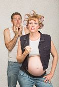 foto of headstrong  - Intimidating pregnant hillbilly woman with scared husband - JPG