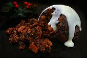 traditional English Christmas pudding with white sauce