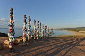 stock photo of pagan  - Buryat traditional pagan holy poles by Lake Baikal - JPG