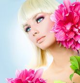 Beauty Blonde Girl with Short White Hair and Blue Eyes. Big Pink Dahlia Flowers. Beautiful Blond Woman Portrait