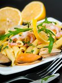Pasta with mussels, shrimp and lemon, mediterranean cuisine
