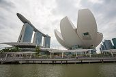 SINGAPORE - NOVEMBER 05, 2012: Promenade overlooking the Marina Bay Sands and Art Science Museum. Th