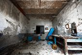 picture of locksmith  - an old empty desolate dirty locksmith workshop poor light - JPG