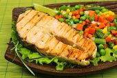 Tasty grilled salmon with vegetables, on bamboo mat
