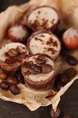 Tasty chocolate candies with coffee beans and nuts, close up