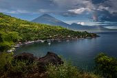 Calm lagoon with mountains at rainy day. Bali, Indonesia