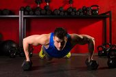 push-up strength man hex dumbbells pushup exercise workout at gym