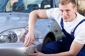 Mechanic Repairing Car Scratching
