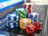 Virtual casino. Online gambling. Laptop with dice and chips. 3d