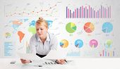 Business woman with colorful charts graphs