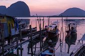 Dusk in the Koh Panyi Muslim fishing village in the Pang Nga bay, Thailand