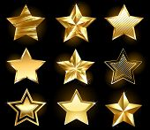 stock photo of jewelry  - Set of gold fine stars on a black background - JPG