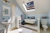 picture of tub  - Light blue velux bathroom with window - JPG