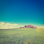 stock photo of farmhouse  - Farmhouse Surrounded by Sloping Meadows of Tuscany Photo Filter - JPG