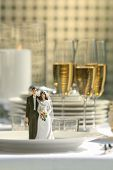 Close-up of cake figurines on dinner plate at reception