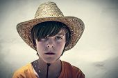 Portrait Of A Male Teenager With Straw Hat, Vintage Color Filer