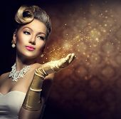 Retro Woman with magic in her hand. Beauty Fashion Vintage Style Lady with Beautiful Luxury Hairstyl