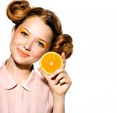Beauty Model Girl with Juicy Oranges. Beautiful Joyful teen girl with freckles, funny red hairstyle