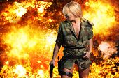 Hot blonde woman with gun over exploding background