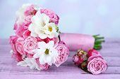 stock photo of boutonniere  - Beautiful wedding bouquet and boutonniere on table on bright background - JPG