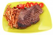 meat food : big grill beef meat steak on green square plate with dry hot chili pepper and cherry tom