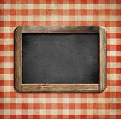 old chalkboard on picnic tablecloth