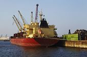 stock photo of scrap-iron  - The loading of scrap iron on a cargo vessel at the harbor of Hamburg - JPG