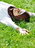 Beautiful Middle Eastern Arabic girl having relaxing time in nature