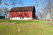 Weathered Red Barn On A Hill