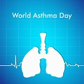 World Asthma Day concept with illustration of human lungs on blue background.