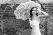 Beautiful Bride In White Dress With Umbrella