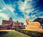 Vintage retro hipster style travel image of Hindu temple Gangai Konda Cholapuram with giant statue o