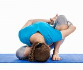 Yoga - young beautiful slender woman yoga instructor doing Forward Bends Sage Twist B pose (Marichya