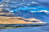 High dynamic range image valley in Himalayas. with sand dunes. Hunder, Nubra valley, Ladakh, India