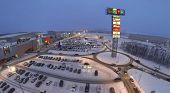 SAMARA, RUSSIA - JAN 05, 2014 : Aerial view to superstore Mega in Samara with car parking in evening