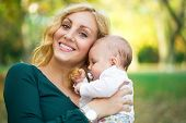loving mother with baby girl outdoor