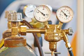 stock photo of tig  - welding equipment acetylene gas cylinder tank with gauge regulators manometers - JPG