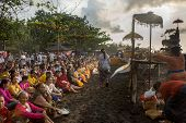BALI, INDONESIA - SEPTEMBER 19, 2014: Families gather at the beach for the Nyaben 12th day ceremony,