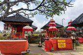 BALI, INDONESIA - SEPTEMBER 20, 2014: The red cloth covered shrine and altar at the Besakih Temple serves the Chinese immigrants on Bali Island. Many significant religious events are held here.