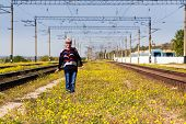 Woman Standing Near A Railway