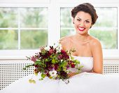 Bride Holding Unusual Wedding Bouquet With Succulent Flowers And Hop