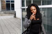 Attractive Young African-american Woman Smoking