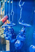 Industrial globe valves in painting area