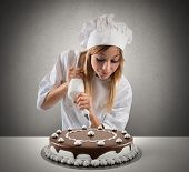 Pastry Cook Prepares A Cake