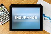 Insurance Word On Digital Tablet