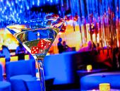 pic of dice  - red dice in the cocktail glass in front of lounge bar casino casino concept - JPG