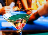 foto of champagne color  - cocktail glass in front of gambling table casino concept - JPG