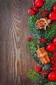 image of christmas spices  - Christmas wooden background with spices and Christmas ornament - JPG